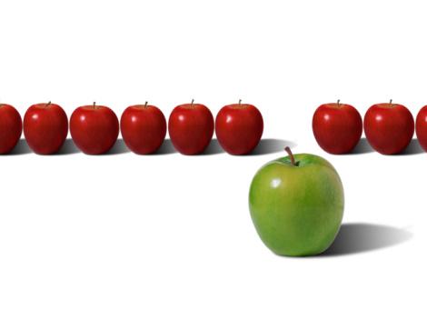 リンゴ「Green apple in front of row of red apples (digital composite)」:スマホ壁紙(12)