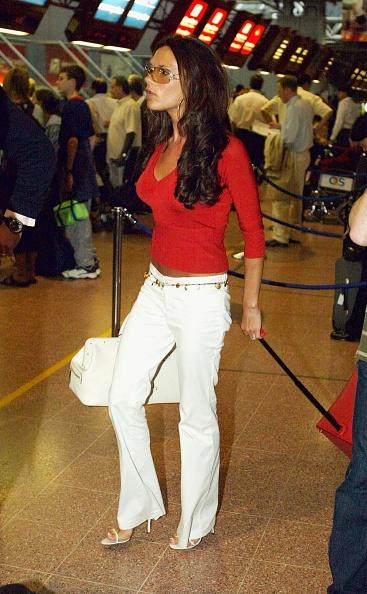 Heathrow Airport「David Beckham And His Wife Victoria Arrive At Heathrow Airport」:写真・画像(16)[壁紙.com]