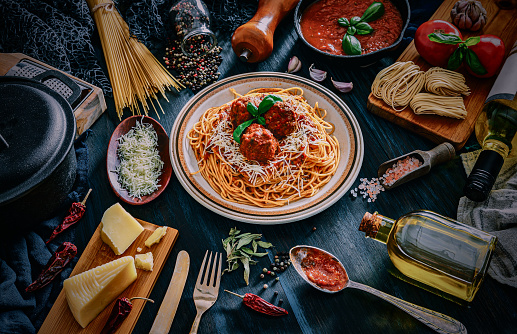 Dietary Fiber「Spaghetti with meatballs and and ingredients on rustic pots. Shot taken on wooden bluish table in rustic kitchen」:スマホ壁紙(0)