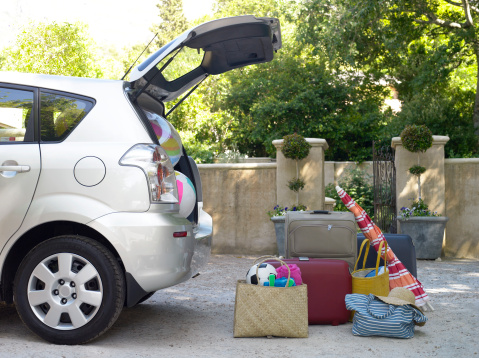 Weekend Activities「Car with boot open and beach equipment and cases」:スマホ壁紙(4)