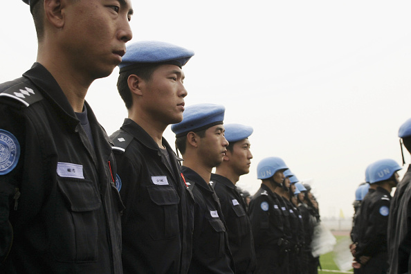 Beret「China's First UN Peacekeeping Force Prepares To Depart For Haiti」:写真・画像(18)[壁紙.com]