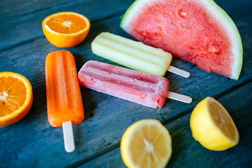 スイカ「Orange, lemon and watermelon snow ice cream on blue wood」:スマホ壁紙(3)