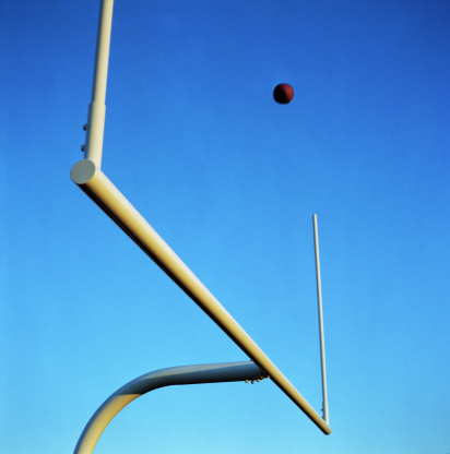 Goal Post「Football flying through field posts, view from below (selective focus)」:スマホ壁紙(5)