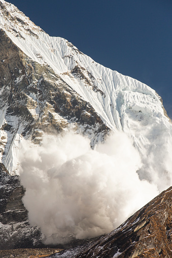 Annapurna Conservation Area「An avalanche on Machapuchare or Fishtail Peak in the Annapurna Himalaya, Nepal.」:スマホ壁紙(7)