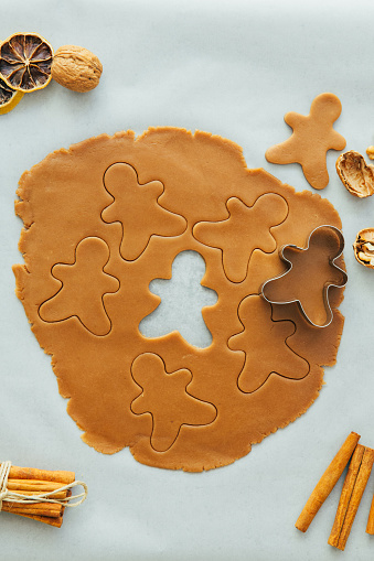 Cookie「Gingerbread man cookie cutter with gingerbread dough」:スマホ壁紙(2)