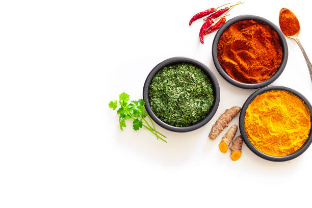 Spices: Turmeric, pepper powder and dried parsley shot from above on white background:スマホ壁紙(壁紙.com)
