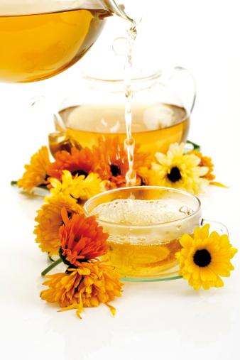 Teapot「Calendula tea being poured into tea cup, close-up」:スマホ壁紙(6)