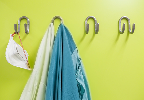 Medical Scrubs「Lab coats and mouth mask at coat hook」:スマホ壁紙(4)
