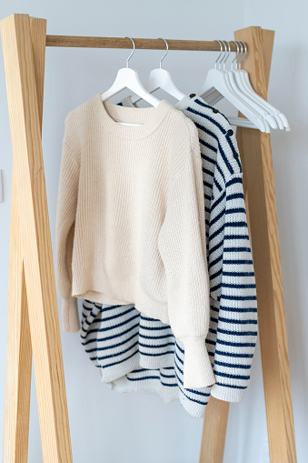 Sweater「Pullovers hanging on clothes rack」:スマホ壁紙(19)