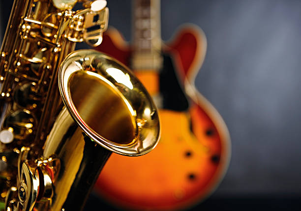 Close up on saxophone with guitar in background. Jazz rules!:スマホ壁紙(壁紙.com)