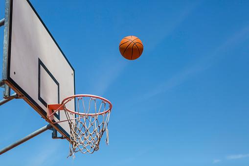 Low Angle View「Basketball and hoop, blue sky」:スマホ壁紙(19)