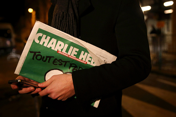 Charlie Hebdo「First International Edition Of Charlie Hebdo Published Since Paris Terror Attacks」:写真・画像(8)[壁紙.com]