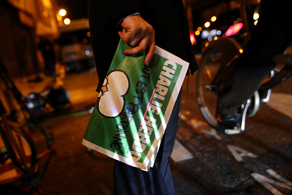 Charlie Hebdo「First International Edition Of Charlie Hebdo Published Since Paris Terror Attacks」:写真・画像(14)[壁紙.com]