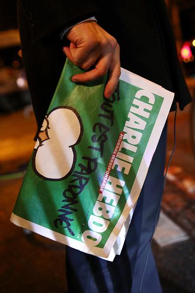 Charlie Hebdo「First International Edition Of Charlie Hebdo Published Since Paris Terror Attacks」:写真・画像(10)[壁紙.com]