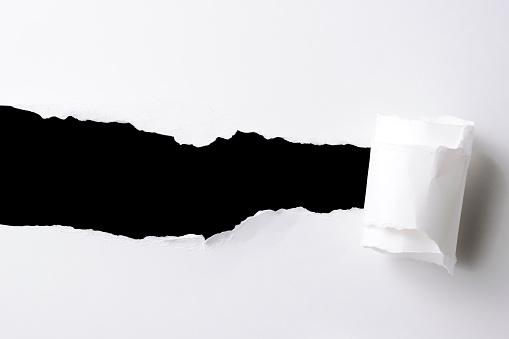 Destruction「Rectangle hole in the white paper against black background」:スマホ壁紙(0)