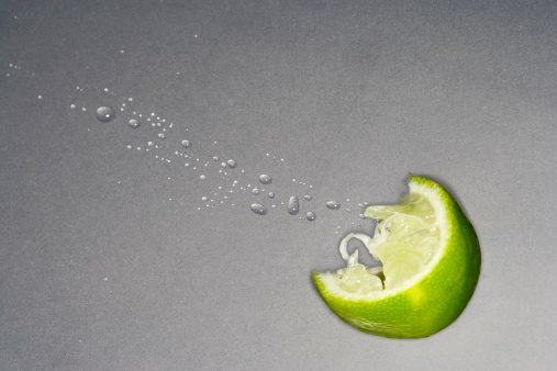 Gray Background「squeezed lime wedge with spray droplets」:スマホ壁紙(1)