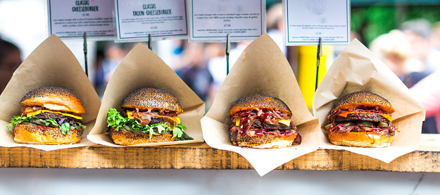 City Life「Fresh flame grilled burgers displayed in a row at food market」:スマホ壁紙(15)