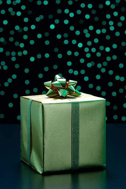 Elegant gift box with gold ribbon against green illumination background:スマホ壁紙(壁紙.com)