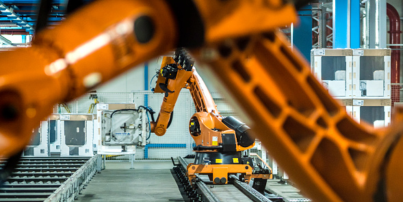 Cable「Photo of two robotic arms doing work in a factory assembly line」:スマホ壁紙(4)