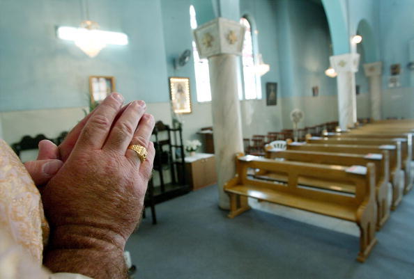 Church「Catholic Priest's Congregation Under Curfew」:写真・画像(0)[壁紙.com]