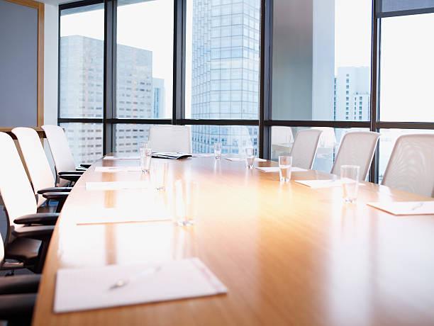 Empty boardroom table with paperwork:スマホ壁紙(壁紙.com)