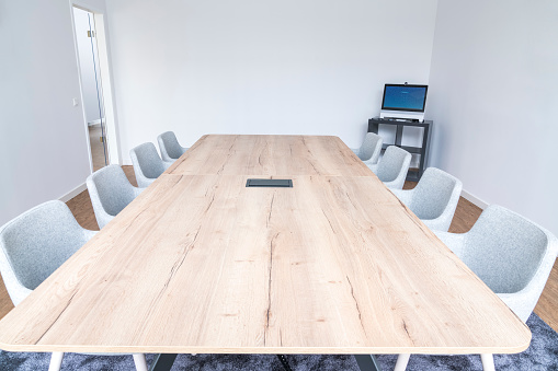 Meeting「Empty board room with wooden conference table」:スマホ壁紙(0)