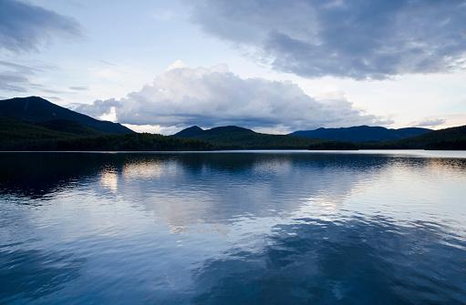 Adirondack State Park「USA, New York State, Lake Placid, Clouds reflecting in lake at dusk」:スマホ壁紙(17)