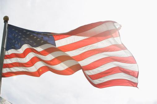 Patriotism「USA, New York State, New York City, American flag against sky」:スマホ壁紙(2)