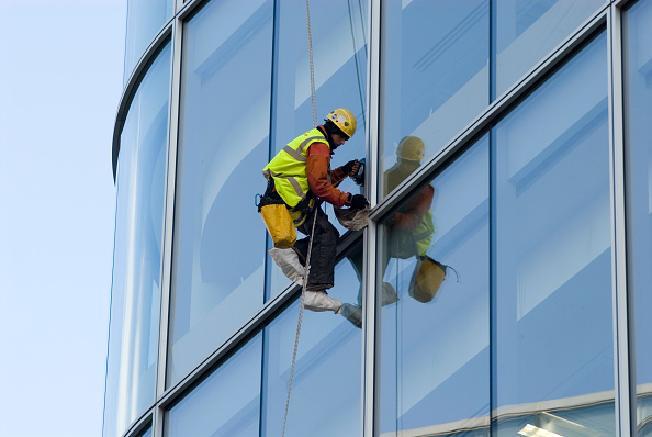 Construction Industry「Men cleaning windows of modern offices, UK」:写真・画像(19)[壁紙.com]
