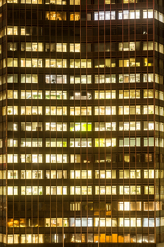 Employment And Labor「An office block lit up at night.」:スマホ壁紙(17)