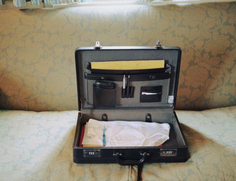 Briefcase「Open briefcase revealing clean underwear and toothbrush」:スマホ壁紙(6)