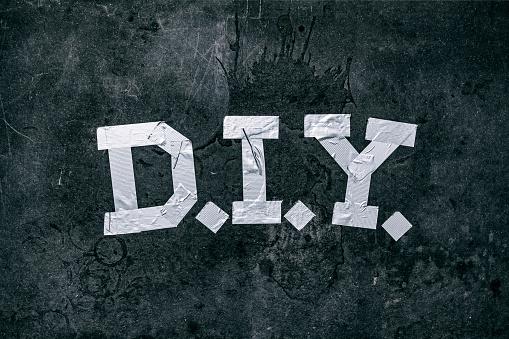 趣味・暮らし「Duct tape forming the letters 'DIY'」:スマホ壁紙(1)