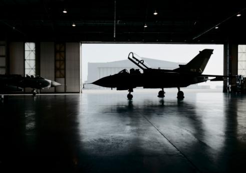 Military「Plane inside aircraft hanger 」:スマホ壁紙(3)