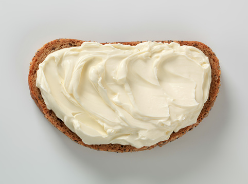 Cream Cheese「Slice of bread, spread with cheese against white background」:スマホ壁紙(5)