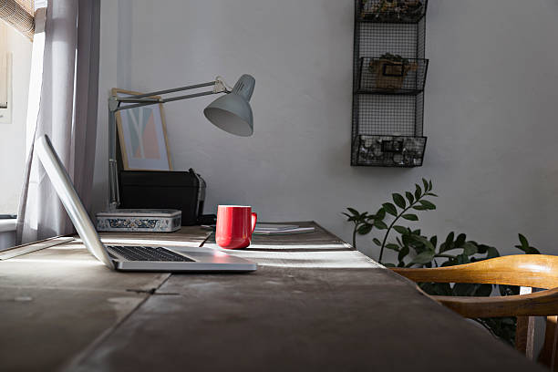 Desk with laptop and coffee cup at home office:スマホ壁紙(壁紙.com)