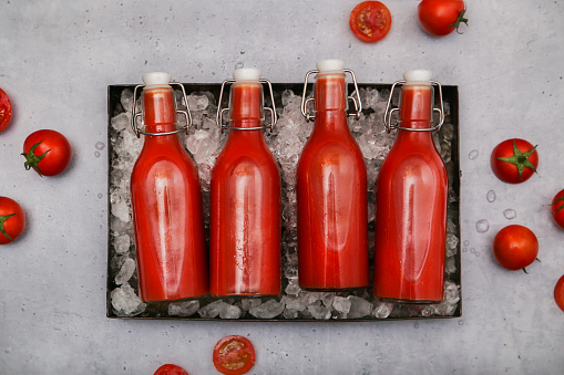 Vegetable Juice「Row of four ice-cooled swing top bottles with homemade tomato juice」:スマホ壁紙(9)