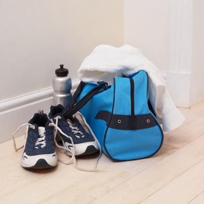 スポーツ「Elevated view of sports bag and water bottle and running shoes and a towel」:スマホ壁紙(3)