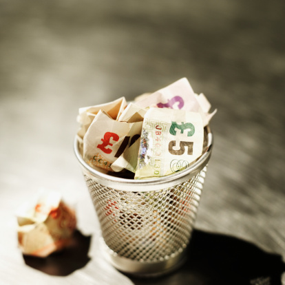 Carefree「Elevated view of crumpled U.K.. pound notes in rubbish bin」:スマホ壁紙(12)