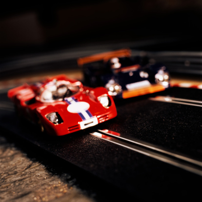 Motor Racing Track「Electric slot cars, close-up (focus on red car)」:スマホ壁紙(13)
