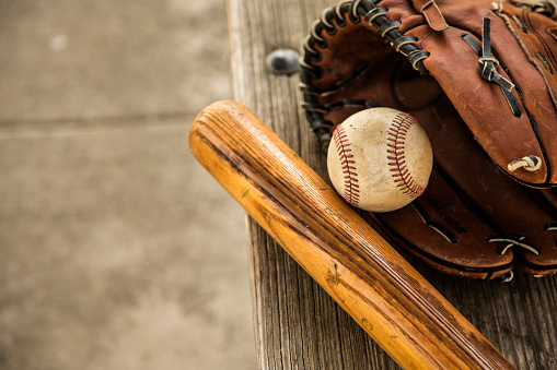 Leisure Games「Baseball season is here.  Bat, glove and ball on dugout bench.」:スマホ壁紙(3)