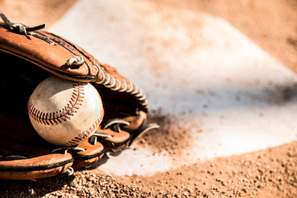 Baseball season is here.  Glove and ball on home plate.:スマホ壁紙(壁紙.com)