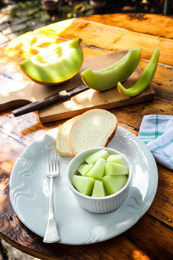 Plate「Sliced ripe melon served with bread as Summer snack.」:スマホ壁紙(10)