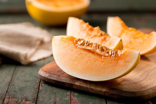 Rutting「Sliced ripe melon on a cutting board」:スマホ壁紙(1)