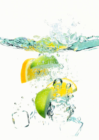 Vitality「Ice cubes and wedges of  lemon and lime floating in liquid」:スマホ壁紙(2)