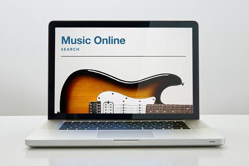 Guitar「Laptop computer with Music Online on screen」:スマホ壁紙(19)
