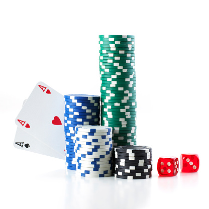 Gambling「Pocket aces poker hand hiding behind a stack of poker chips」:スマホ壁紙(19)