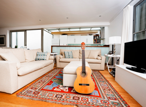 Iranian Culture「Modern living room interior with classic acoustic guitar」:スマホ壁紙(19)