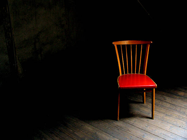 Wood chair with red seat in dark room with wood floor:スマホ壁紙(壁紙.com)