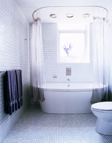 Tile「Light Blue Tiled Bathroom with White Bathtub by Window」:スマホ壁紙(6)