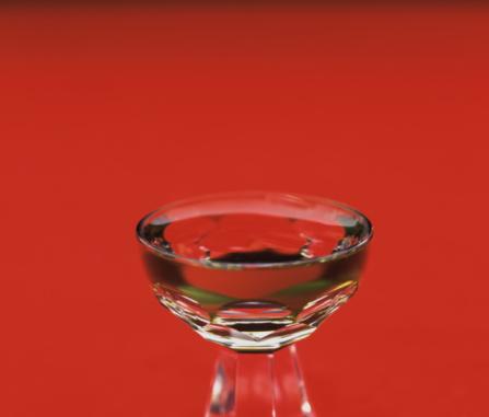 Sake「Glass of Sake, close up, red background」:スマホ壁紙(7)